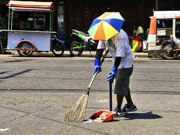 unique practical person cleaning service on the street