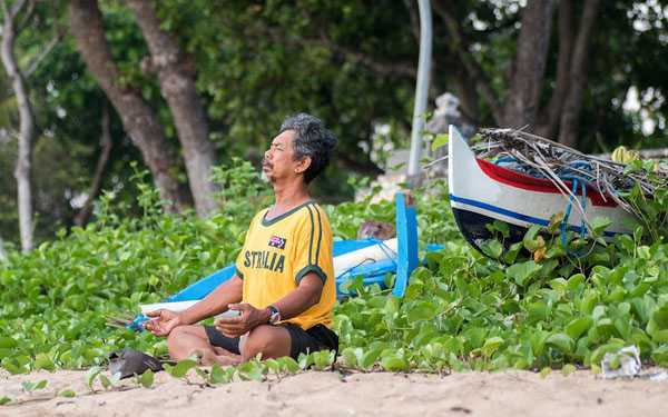 a man sitting with daily routine in the morning beach