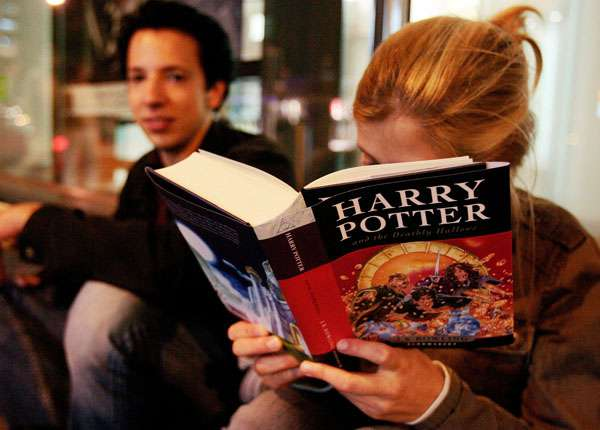 woman reading reading harry potter book jpg