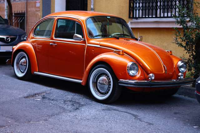 photography-of-orange-volkswagen-beetle image