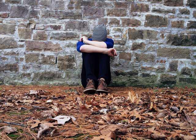 adult-alone-autumn-brick img