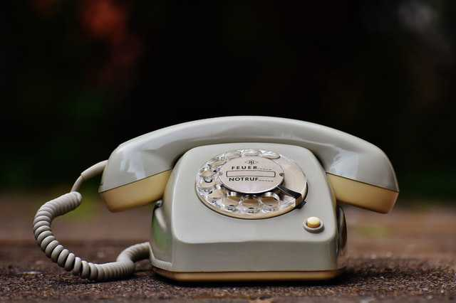 antique-close-up-cord-dial-phone ringing img