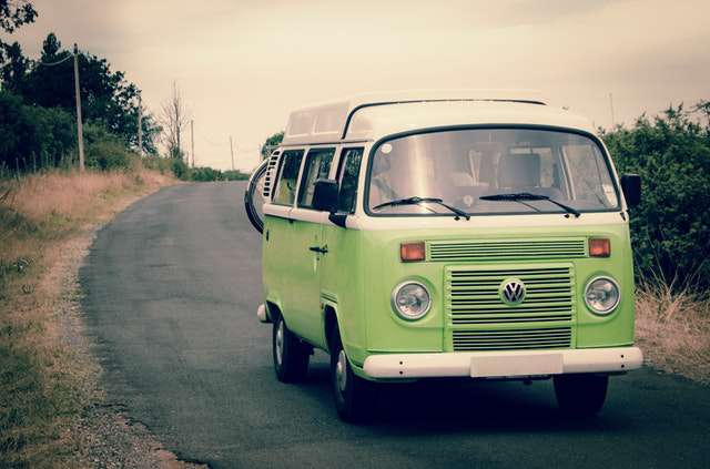 green-and-white-volkswagen-combi-bus img