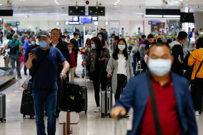 passengers arrival from wuhan china in airport photo